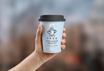 Free Medium and Small Cup In Hand Mockup PSD