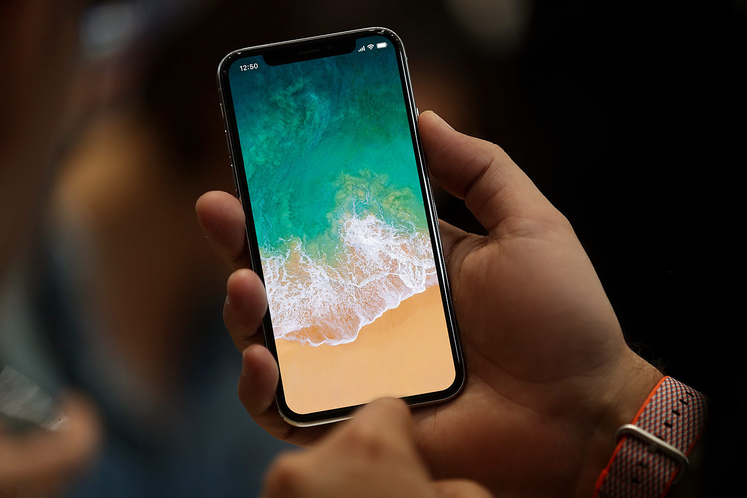 iPhone X with Status Bar in Hand Free Mockup