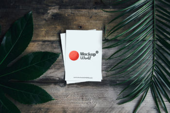 Free Greeting Card on Wooden Background Mockup