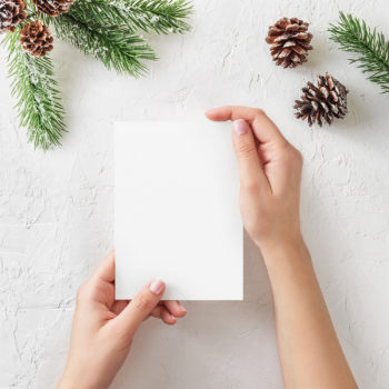 Free Christmas Card Mockup in Hands