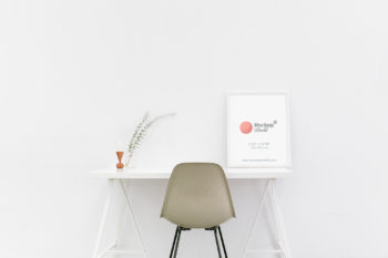 White Photo Frame Mockup on a Table in Minimalist Interior