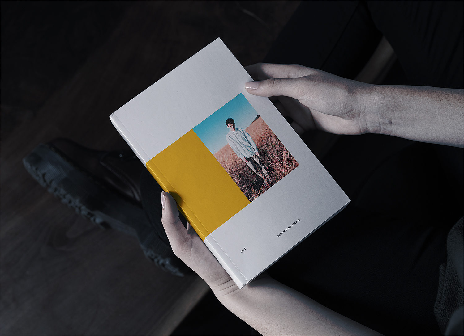 Book in Hand Softcover Free Mockup