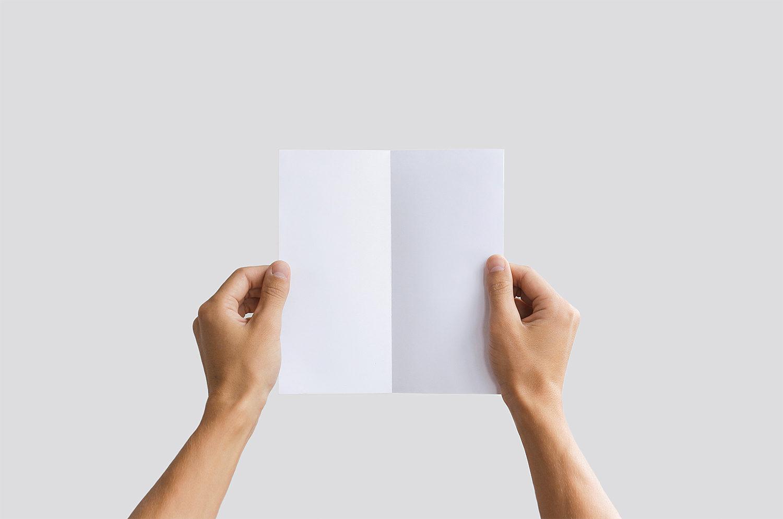 Man Holding Bifold Brochure Mockup