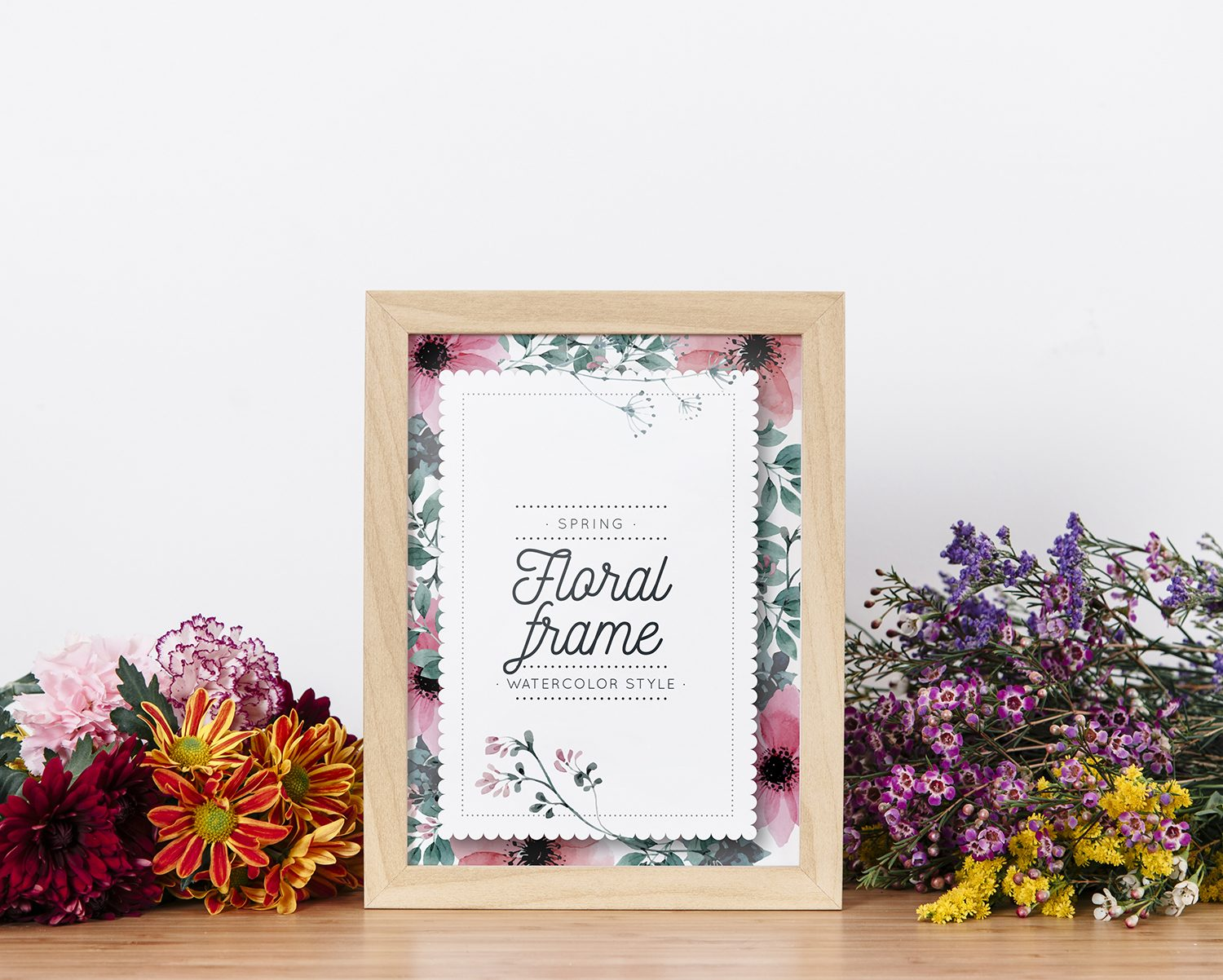 Mockup of Frame Between Beautiful Flowers Free PSD