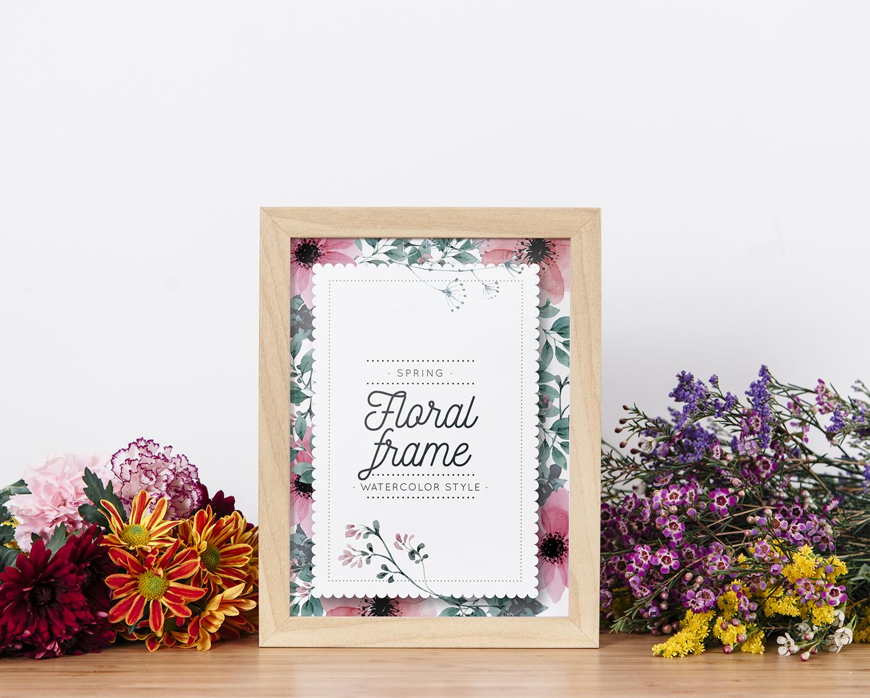 Mockup of Frame Between Beautiful Flowers Free PSD