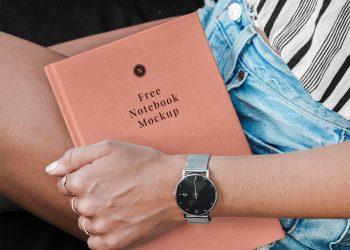 Hand Holding Hardcover Notebook/Catalog Free Mockup